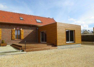 Agrandissement pour la création d'un séjour en bardage tonmiel et toiture terrasse